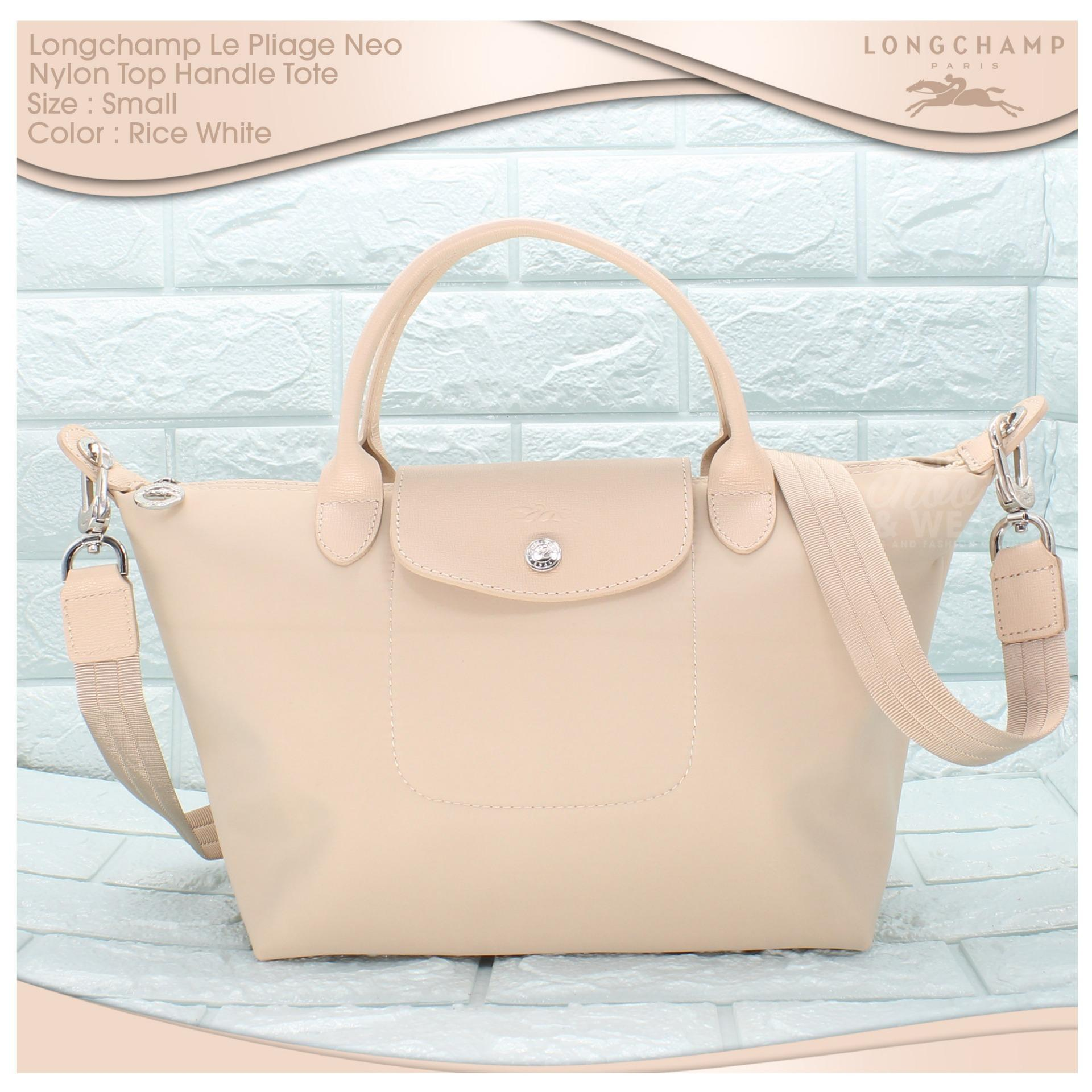 51ac81c91a63 Authentic Longchamp Made In France Le Pliage Neo Small Top Handle Tote -  Light GrayPHP1850. PHP 1.850