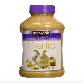 Kirkland Signature Minced California Garlic, 48 Ounce with Free Arm& Hammer Fridge-N-Freezer Baking Soda 14oz (396.8g)