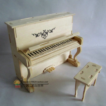 Young student's handmade DIY for making assembled piano dimensional puzzle